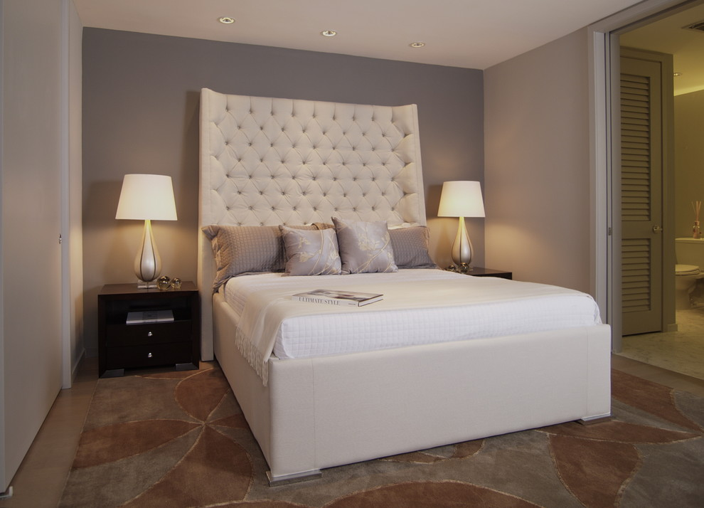 How tall should bedroom lamps be compared to a headboard